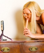 Aaliyah Love cellphone toying with a candlestick