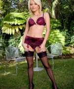 Art Lingerie blonde in purple lingerie gets naked but leaves on the stockings.