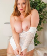 Busty Jenny Baxter teasing her huge boobs in a tight white lace bodysuit