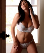 Digital Desire babe Jelena Jensen strips out of her white lingerie.