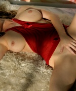 Digital Desire beautiful blonde in red sheer dress shows off her massive boobs.