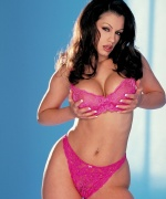 Digital Desire babe Aria Giovanni takes off her underwear and shows off her big boobs.