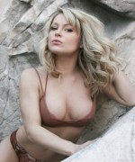 madden teases her bigger boobs up the mountain