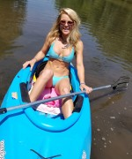 Madden shows her bikini body  while taking the kayak out on the river