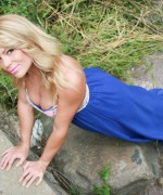 Madden goes for a country walk and teases her legs in a  long skirt