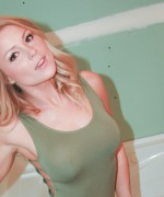 Madden is re modeling her bathroom in a tight green bodysuit as her nipples get hard.