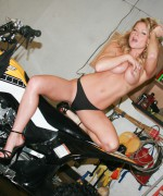 Madden is not just working on her ATV in the garage but that amazing body of hers as she gets totally topless