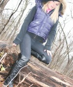 Madden goes for a walk in the woods and teases her slim body and she opens her shirt to reveal her pink bra