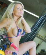 Madden is in the garage with her ATV teasing in a tiny bikini as she spreads herself over her ATV
