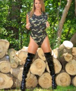 Nikki sims going down the woods in camo and her kinky boots.