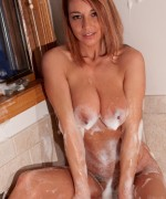 Nikki sims shows off her huge boobs while having a soapy bath
