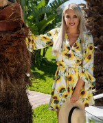 Photo dromm Margot Nude in the garden as she strips out of her very yellow summer dress to be naked with nature