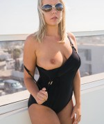 Millie F Bikini strip tease and she flahes her big natural boobs on the roof top