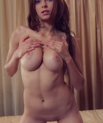 Yuki Busty New Model teasing her huge boobs as she strips nude on her first shoot click for more updates.