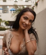 sofi ryan teases her big boobs in a stunning dress before flashing them big boobs at the table