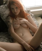 Zishy Wanda Ablee strips off in the bedroom as she stands totally naked