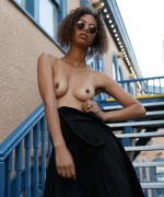 Desiree Jacobsen Zishy pictures as this stunning babe gets topless and shows off her hard nipples for you